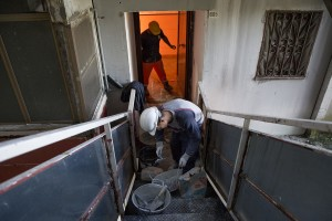 "Workers wall up an apartment just abandoned by a family all inside one of the ""Vele"" of Scampia, to prevent the occupation of the house by new families, in Naples on November 10, 2016. The ""vele"" of Scampia, become famous for the long and bloody Camorra feuds, will be demolished starting from spring 2017."