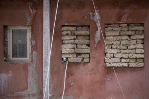 """The windows of an apartment just abandoned by a family all inside one of the """"Vele"""" of Scampia, walled to prevent the occupation of the house by new families, in Naples on November 24, 2016. The """"vele"""" of Scampia, become famous for the long and bloody Camorra feuds, will be demolished starting from spring 2017."""