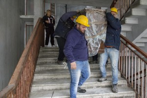 """People at work during the transfer of a family from an apartment inside the """"Vele"""" of Scampia to a new accommodation realized always in Scampia, in Naples on November 11, 2016. The """"vele"""" of Scampia, become famous for the long and bloody Camorra feuds, will be demolished starting from spring 2017."""