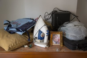 "An iron and other objects are seen in a room after the transfer of a family from their old house in one of the ""vele"" of Scampia to a new accomodation, in Naples on November 25, 2016. The ""vele"" of Scampia, become famous for the long and bloody Camorra feuds, will be demolished starting from spring 2017."