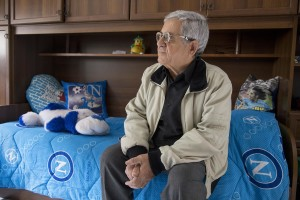 "Mario Benfenati, 75, is seen inside the new accomodation of his sons after their transfer from the ""vele"" of Scampia, in Naples on November 25, 2016. The ""vele"" of Scampia, become famous for the long and bloody Camorra feuds, will be demolished starting from spring 2017."