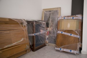 """Furniture and paintings are seen in a room after the transfer of a family from their old house in one of the """"vele"""" of Scampia to a new accomodation, in Naples on November 25, 2016. The """"vele"""" of Scampia, become famous for the long and bloody Camorra feuds, will be demolished starting from spring 2017."""