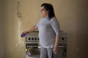 "Carmela Mele is seen in her new accomodation after the transfer from the ""vele"" of Scampia, in Naples on November 28, 2016. The ""vele"" of Scampia, become famous for the long and bloody Camorra feuds, will be demolished starting from spring 2017."