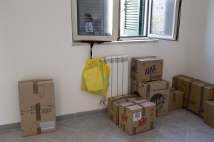 """Boxes are seen in a room after the transfer of a family from their old house in one of the """"vele"""" of Scampia to a new accomodation, in Naples on November 28, 2016. The """"vele"""" of Scampia, become famous for the long and bloody Camorra feuds, will be demolished starting from spring 2017."""