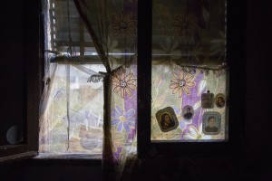 """Holy images attached on the window of the apartment of Filippo Leone who is under house arrest and is waiting for the allocation of a new housing in Scampia, Naples on November 24, 2016. The """"vele"""" of Scampia, become famous for the long and bloody Camorra feuds, will be demolished starting from spring 2017."""