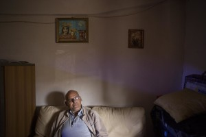 "Filippo Leone, under house arrest, is seen in his apartment inside one of the ""Vele"" of Scampia, waiting for the allocation of a new housing, in Naples on November 24, 2016. The ""vele"" of Scampia, become famous for the long and bloody Camorra feuds, will be demolished starting from spring 2017."