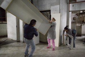 "People are seen during the transfer from an apartment inside the ""Vele"" of Scampia to a new accommodations realized always in Scampia, in Naples on November 11, 2016. The ""vele"" of Scampia, become famous for the long and bloody Camorra feuds, will be demolished starting from spring 2017."
