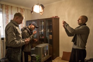 Igor, Nik and Aleksei prepare syringes of fentanyl inside Igor's house in Lasnamae district, an area where drug addicts usually go to use drug in Tallinn, Estonia on March 22, 2017.