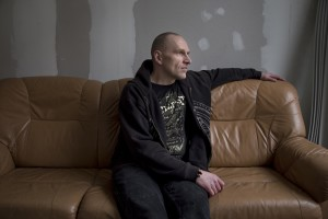 Andrei, 50 years old relaxes on a sofa of Convictus center in Tallinn, Estonia on March 20, 2017. Andrei has been using fentanyl for about five years, since he was arrested for drug possession in 2007 and released after one year and half. He has been working for about eight years at Convictus center trying to help people to stop drug use.