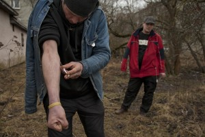 Tarmo, 33 years old and Mart, 35 years old inject a dose of fentanyl inside a park of Majaka, in Tallinn, Estonia on March 19, 2017. Majaka is considered to be among the neighborhoods with the higest number of fentanyl addicts in the city.