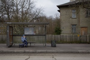 A woman waits for the bus sitting on a bench of a bus stop in Kopli, a suburb of Tallinn, Estonia on March 18, 2017. Kopli is considered one of the neighborhoods with the higest number of fentanyl addicts in the city.