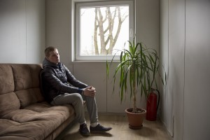 Arthur, 23 years old sits on a sofa in Tugikeskus aids and support center after his methadone treatment in Tallinn, Estonia on March 22, 2017. Arthur has been using fentanyl for about five years. From 2013 to 2015 he has been in prison since he was discovered selling fentanyl in the street and because of his drug problems he doesn't hear his family for two years.