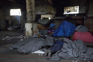 A migrant sleeps on the ground of an abandoned warehouse where he and other migrants took refuge in Belgrade, Serbia on February 4, 2017. Hundreds of migrants have been sleeping in freezing conditions in central Belgrade looking for ways to cross the heavily guarded EU borders.