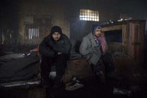Migrants rest inside an abandoned warehouse in Belgrade, Serbia on February 3, 2017. Hundreds of migrants have been sleeping in freezing conditions in downtown Belgrade looking for ways to cross the heavily guarded EU borders.
