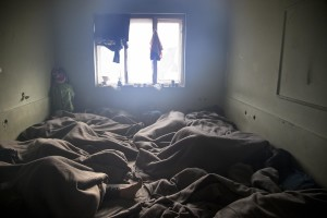 Migrants sleep on the ground of an abandoned warehouse where they took refuge in Belgrade, Serbia on February 4, 2017. Hundreds of migrants have been sleeping rough in freezing conditions in central Belgrade looking for ways to cross the heavily guarded EU borders.