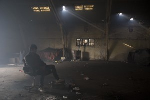 A migrant rests on a chair inside an abandoned warehouse in Belgrade, Serbia on February 3, 2017. Hundreds of migrants have been sleeping in freezing conditions in downtown Belgrade looking for ways to cross the heavily guarded EU borders.