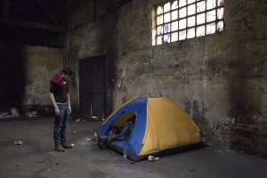 Migrants enter in a tent inside an abandoned warehouse in Belgrade, Serbia on February 3, 2017. Hundreds of migrants have been sleeping in freezing conditions in downtown Belgrade looking for ways to cross the heavily guarded EU borders.