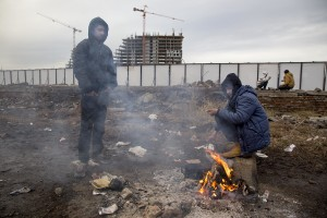 Migrants gather around a fire to warm themselves from the morning cold outside an abandoned warehouse where they are taking refuge, in Belgrade, Serbia on February 3, 2017. Hundreds of migrants have been sleeping in freezing conditions in central Belgrade looking for ways to cross the heavily guarded EU borders.