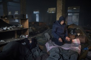 A migrant prays in an abandoned warehouse where he and other migrants took refuge in Belgrade, Serbia on February 4, 2017. Hundreds of migrants have been sleeping in freezing conditions in central Belgrade looking for ways to cross the heavily guarded EU borders.