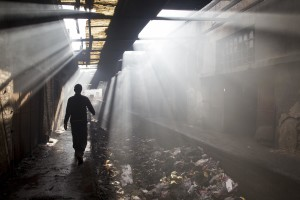 A migrant walks inside an abandoned warehouse where he and other migrants took refuge in Belgrade, Serbia on February 4, 2017. Hundreds of migrants have been sleeping in freezing conditions in central Belgrade looking for ways to cross the heavily guarded EU borders.