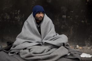 A migrant rests outside an abandoned warehouse where he and other migrants took refuge in Belgrade, Serbia on February 6, 2017. Hundreds of migrants have been sleeping in freezing conditions in central Belgrade looking for ways to cross the heavily guarded EU borders.