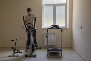 Ali Hassan from Pakistan plays gymnastics inside the headquarter of Chianche Sprar (Protection systems for asylum seekers and refugees) near Petruro Irpino, southern Italy on June 14, 2017. Petruro Irpino is an Italian small village with 367 inhabitants in the province of Avellino in Campania, which is claiming to be an efficient model of integration and where people of different religions and coming from different parts in the world peaceful live together.