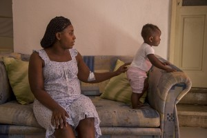 Alima Ibrahim from Nigeria and beneficiary of the protection systems for asylum seekers and refugees is seen with her daughter Mariella in the house where she lives in Petruro Irpino, southern Italy on June 14, 2017. Petruro Irpino is an Italian small village with 367 inhabitants in the province of Avellino in Campania, which is claiming to be an efficient model of integration and where people of different religions and coming from different parts in the world peaceful live together.