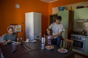 Anastas Issa, Christian from Palestine and Ali Hassan, Muslim from Pakistan and beneficiaries of the protection systems for asylum seekers and refugees, are seen in the kitchen of the house where they live in Chianche, near Petruro Irpino, southern Italy on June 14, 2017. Petruro Irpino is an Italian small village with 367 inhabitants in the province of Avellino in Campania, which is claiming to be an efficient model of integration and where people of different religions and coming from different parts in the world peaceful live together.