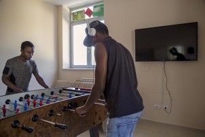 Yaya Darboo from Gambia and Abdirahman Mamud from Somalia play table football inside the headquarter of Chianche Sprar (Protection systems for asylum seekers and refugees) near Petruro Irpino, southern Italy on June 14, 2017. Petruro Irpino is an Italian small village with 367 inhabitants in the province of Avellino in Campania, which is claiming to be an efficient model of integration and where people of different religions and coming from different parts in the world peaceful live together.