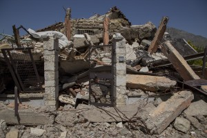 A collapsed building is seen almost one year after the earthquake in the village of Amatrice, central Italy on August 2, 2017. Italy was struck by a powerful 6.2 magnitude earthquake in the night of August 24, 2016 which has killed at least 297 people and devastated dozens of houses in the Lazio village of Amatrice and other Amatrice fractions.