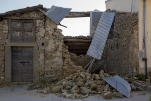 A collapsed building is seen almost one year after the earthquake in the village of Retrosi, central Italy on July 31, 2017. Italy was struck by a powerful 6.2 magnitude earthquake in the night of August 24, 2016 which has killed at least 297 people and devastated dozens of houses in the Lazio village of Amatrice and other Amatrice fractions.