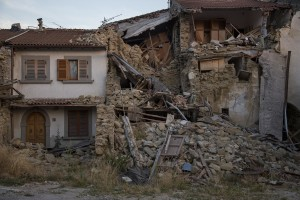 A collapsed building is seen almost one year after the earthquake in the village of Prato, central Italy on July 31, 2017. Italy was struck by a powerful 6.2 magnitude earthquake in the night of August 24, 2016 which has killed at least 297 people and devastated dozens of houses in the Lazio village of Amatrice and other Amatrice fractions.