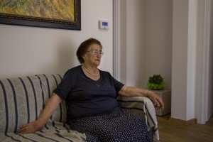 Concetta Renzi, 87 years old is portrayed inside the new house where she lives after her old one was destroyed by the earthquake of almost one year ago in the village of Amatrice, central Italy on August 1, 2017. Italy was struck by a powerful 6.2 magnitude earthquake in the night of August 24, 2016 which has killed at least 297 people and devastated dozens of houses in the Lazio village of Amatrice and other Amatrice fractions.