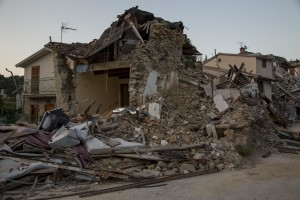 A collapsed building is seen almost one year after the earthquake in the village of Libertino, central Italy on August 1, 2017. Italy was struck by a powerful 6.2 magnitude earthquake in the night of August 24, 2016 which has killed at least 297 people and devastated dozens of houses in the Lazio village of Amatrice and other Amatrice fractions.