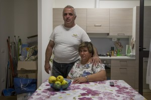 Silvio Puglia, 49 years old and Rita Casini, 49 years old are portrayed inside the new house where they live after their old one was destroyed by the earthquake of almost one year ago in the village of Amatrice, central Italy on August 2, 2017. Italy was struck by a powerful 6.2 magnitude earthquake in the night of August 24, 2016 which has killed at least 297 people and devastated dozens of houses in the Lazio village of Amatrice and other Amatrice fractions.