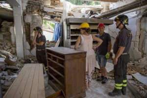 Firefighters help people to find their personal object inside the red zone almost one year after the earthquake in the village of Amatrice, central Italy on August 1, 2017. Italy was struck by a powerful 6.2 magnitude earthquake in the night of August 24, 2016 which has killed at least 297 people and devastated dozens of houses in the Lazio village of Amatrice and other Amatrice fractions.
