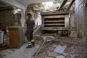 A firefighter works inside the red zone almost one year after the earthquake in the village of Amatrice, central Italy on August 1, 2017. Italy was struck by a powerful 6.2 magnitude earthquake in the night of August 24, 2016 which has killed at least 297 people and devastated dozens of houses in the Lazio village of Amatrice and other Amatrice fractions.