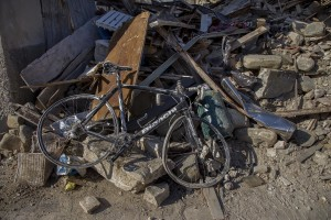 A destroyed bicylce is seen inside the red zone almost one year after the earthquake in the village of Amatrice, central Italy on August 1, 2017. Italy was struck by a powerful 6.2 magnitude earthquake in the night of August 24, 2016 which has killed at least 297 people and devastated dozens of houses in the Lazio village of Amatrice and other Amatrice fractions.