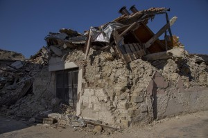 A collapsed building inside the red zone almost one year after the earthquake in the village of Amatrice, central Italy on August 1, 2017. Italy was struck by a powerful 6.2 magnitude earthquake in the night of August 24, 2016 which has killed at least 297 people and devastated dozens of houses in the Lazio village of Amatrice and other Amatrice fractions.