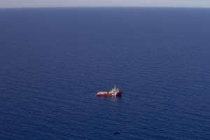 """A picture taken from the moonbird aircraft of the German NGO Sea-Watch shows the migrants rescue operations of Vos Hestia ship run by NGO """"Save the Children"""" in the Mediterranean sea on September 15, 2017."""
