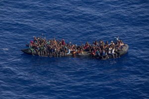 A picture taken from the moonbird aircraft of the German NGO Sea-Watch shows hundreds of migrants inside a rubber dinghy while they try to reach Europe in the Mediterranean Sea on September 15, 2017.