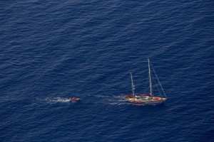 A picture taken from the moonbird aircraft of the German NGO Sea-Watch shows the migrants rescue operations of the Spanish NGO Open Arms in the Mediterranean sea on September 15, 2017.