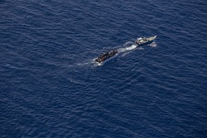 A picture taken from the moonbird aircraft of the German NGO Sea-Watch shows hundreds of migrants inside a rubber dinghy probably intercepted by Libyan militaries while they tried to reach Europe in the Mediterranean Sea on September 15, 2017.