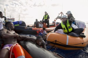 Migrants are rescued by members of German NGO Sea-Watch in the Mediterranean Sea on November 6, 2017. During a shipwreck, five people died, including a newborn child. According to the German NGO Sea-Watch, which has saved 58 migrants, the violent behavior of the Libyan coast guard caused the death of five persons.