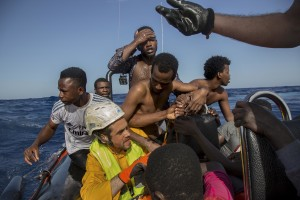 Migrants are rescued by members of German NGO Sea-Watch in the Mediterranean Sea on November 6, 2017. During a shipwreck, five people died, including a newborn child. According to the German NGO Sea-Watch, which has saved 58 migrants, the violent behavior of the Libyan coast guard caused the death of five persons. Alessio Paduano