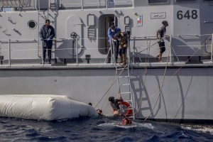 The Libyan Coast Guard tries to recover migrants from a rubber dinghy in the Mediterranean Sea on November 6, 2017. During a shipwreck, five people died, including a newborn child. According to the German NGO Sea-Watch, which has saved 58 migrants, the violent behavior of the Libyan coast guard caused the death of five persons.