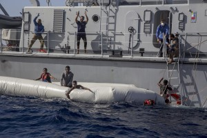 The Libyan Coast Guard tries to recover migrants from a rubber dinghy and invites violently and threateningly the German NGO Sea-Watch – who was performing rescue operations – to go away in the Mediterranean Sea on November 6, 2017. During a shipwreck, five people died, including a newborn child. According to the German NGO Sea-Watch, which has saved 58 migrants, the violent behavior of the Libyan coast guard caused the death of five persons.