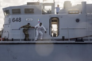 A migrant tries to escape from the Libyan Coast Guard ship after being rescued by them in the Mediterranean Sea on November 6, 2017. During a shipwreck, five people died, including a newborn child. According to the German NGO Sea-Watch, which has saved 58 migrants, the violent behavior of the Libyan coast guard caused the death of five persons. Alessio Paduano