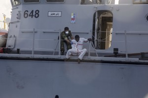 A migrant tries to escape from the Libyan Coast Guard ship after being rescued by them in the Mediterranean Sea on November 6, 2017. During a shipwreck, five people died, including a newborn child. According to the German NGO Sea-Watch, which has saved 58 migrants, the violent behavior of the Libyan coast guard caused the death of five persons.