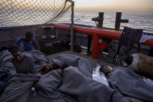 Migrants are seen on board of German NGO Sea-Watch ship after their rescue in the Mediterranean Sea on November 6, 2017. During the shipwreck November 6,2017 five people died, including a newborn child. According to Sea-Watch, which has saved 58 migrants, the violent behavior of the Libyan coast guard caused the death of five persons. Sea-Watch is a non-governmental organisation founded on May, 19 2015 and is formally registered as a non-profit organisation in Berlin.